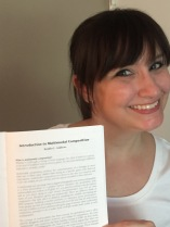 Kendra holding her first publication on Multimodal Composition